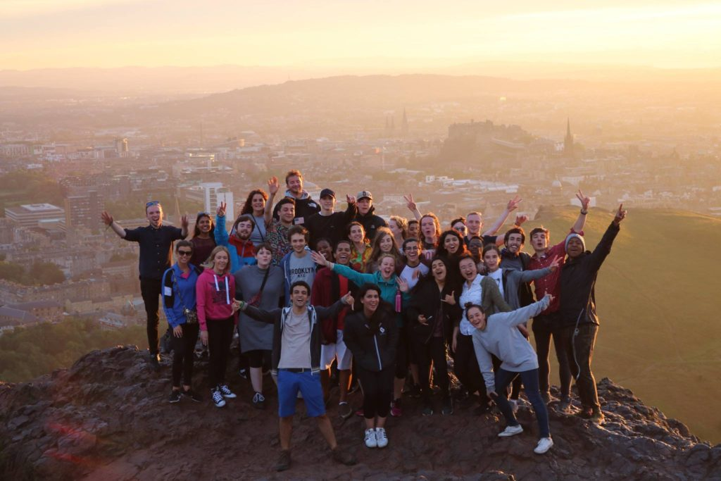 Drivers for Change climb Arthur's Seat in Edinburgh to watch the sunset